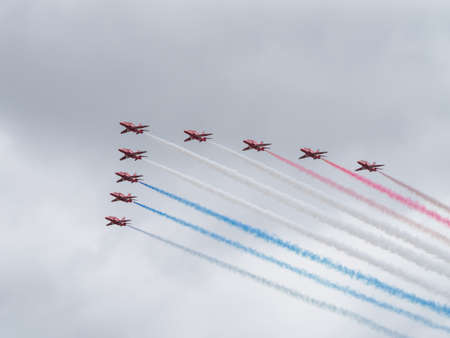 Yeovilton, UK - 11th July 2015: Red Arrows air display team flying at Yeovilton Air Day.
