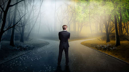 Foto de businessman has to decide which direction is better  - Imagen libre de derechos