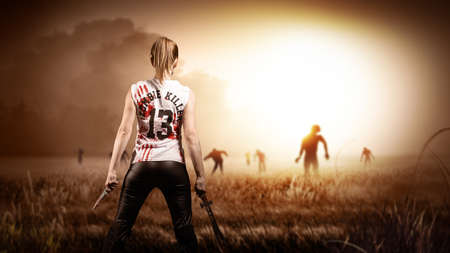 scene like in a horror movie with a woman holding a machete and a knife and standing on a field with approaching zombies