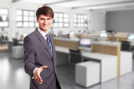 young manager in an office environment ready to shake hands