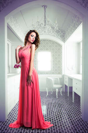 attractive woman with a long dress in a classy bathroom scene