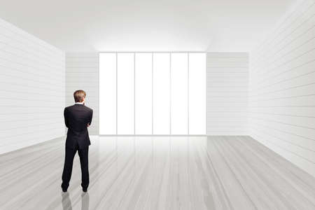 businessman standing in an empty office space