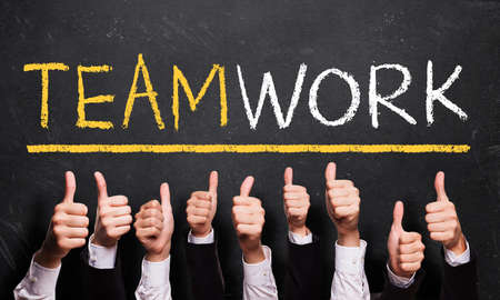 many thumbs up to the word \teamwork\
