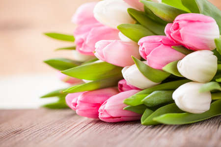 Photo for bouquet of tulips in front of spring scene - Royalty Free Image