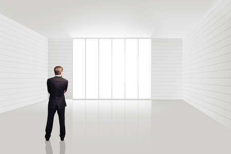 businessman in an empty white room