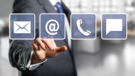 Foto de businessman selecting email as a contact option - Imagen libre de derechos