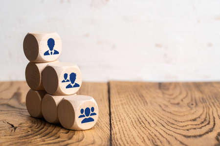Foto per organization and team structure symbolized with cubes - Immagine Royalty Free