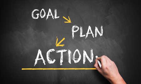 Photo pour hand is writing 'goal, plan, action' on blackboard - image libre de droit