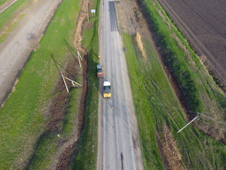Top view of the road repair. Technics for repair of asphalt. Replacement of asphalt pavement
