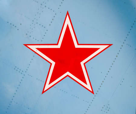 Five-pointed red star on the wing skin of a military fighter.