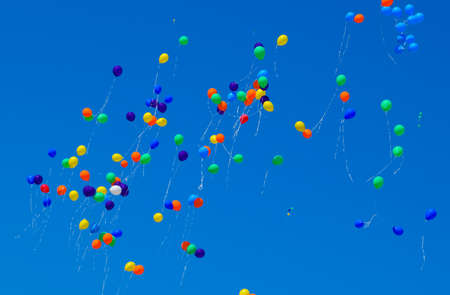 Photo for Multicolored balls, filled with helium, fly in the blue sky. - Royalty Free Image