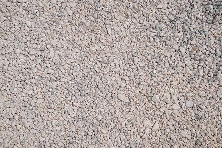 Background texture white crushed stone. Decorative crushed stone