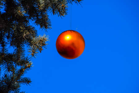 Photo for Tinsel and toys, balls and other decorations on the Christmas Christmas tree standing in the open air. Decorations New Year tree. - Royalty Free Image
