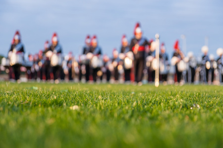 Details from a music, show and marching band. Defocused background with grass and evening sun to use as wallpaper