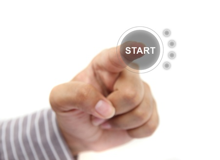 hand pushing start button