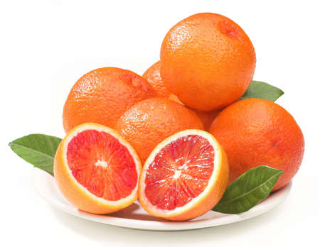 composition of blood oranges on a plate, isolated on white, clipping path provided