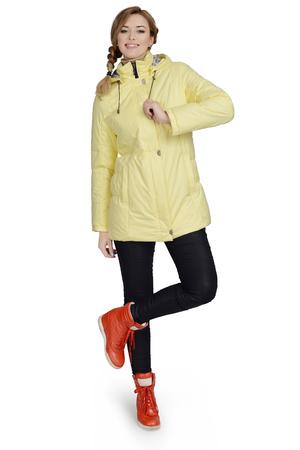 Young woman posing at studio in short coat