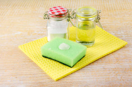 Photo pour Side view of nature and eco friendly natural cleaner baking soda and olive oil paste on washing sponge for cleaning home, removing stains, non toxic cleaning product concept. Copy space. - image libre de droit