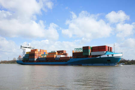 Container ship with cargo on the Kiel Canal, Germany.