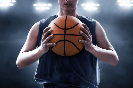 Photo for Basketball player holding a ball - Royalty Free Image