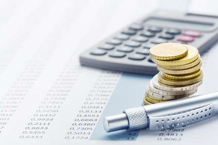 Finance - euro stack, calculators, tables and pens