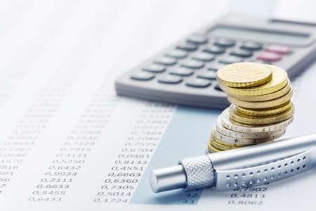 Photo pour Finance - euro stack, calculators, tables and pens - image libre de droit