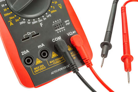 Digital multimeter with probes isolated on a white background