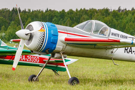 Balashikha, Moscow region, Russia - May 25, 2019: Russian sports and aerobatic aircraft SP-55M RA-2937G parked on a green grass of airfield Chyornoe at Aviation festival Sky Theory and Practice 2019