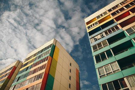Foto de Residential Building on sky background. Colorful Facade of a modern housing construction with of balconies. - Imagen libre de derechos