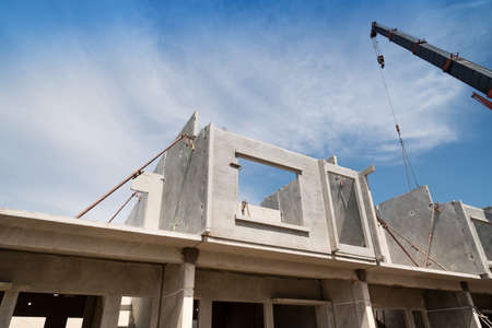 Foto de Installation process of prefabricated wall panels for residential buildings. - Imagen libre de derechos