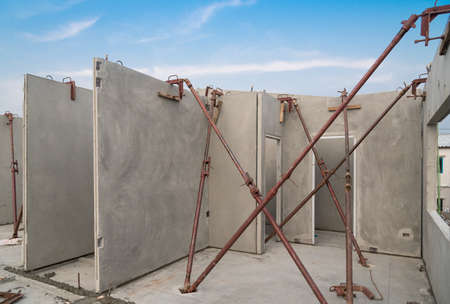 Installation of prefabricated building wall panels supported with u jack.