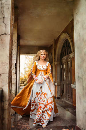 Beautiful lady with blond hairs in medieval dress