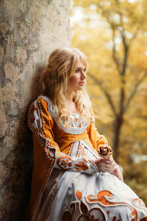 Photo for Beautiful lady with blond hairs in medieval dress - Royalty Free Image