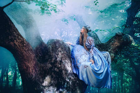 Princess in vintage dress walking in magic forest