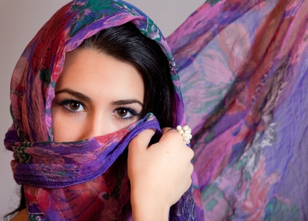 Beautiful Young Multicultural Young Woman covered by a Veil