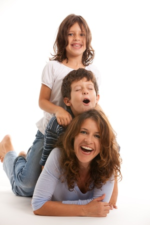 Mother, son and daughter having fun on a white background