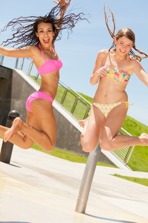 Photo for Beautiful blond and brunette outdoors at a park - Royalty Free Image