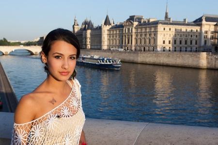 Beautiful young woman enjoying the sights of Paris along the River Seine