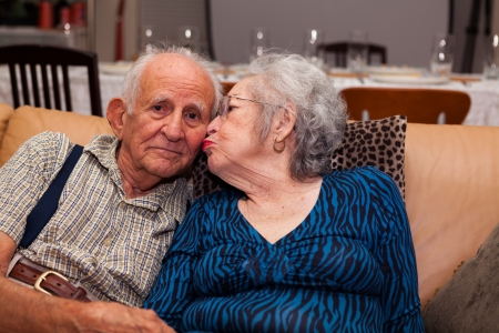 Elderly couple in their 80s being affectionate