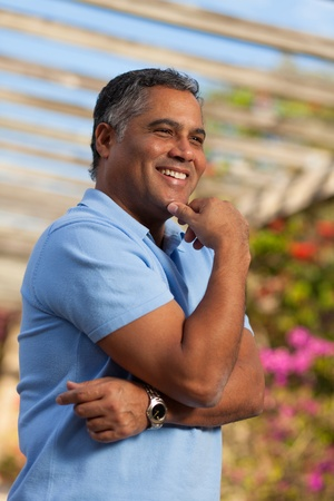 Handsome middle age Hispanic man in casual clothing outdoors