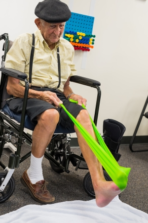 Elderly 80 plus year old man receiving physical therapy の写真素材