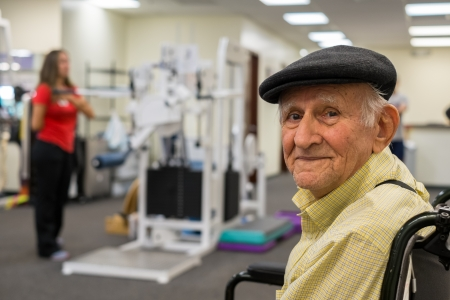 Elderly 80 plus year old man receiving physical therapy