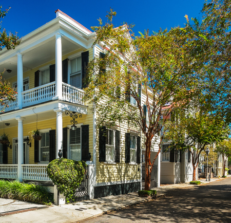 Historic southern style homes in Charleston, South Carolina with fall colors.
