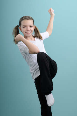 happy child exercising sports movements