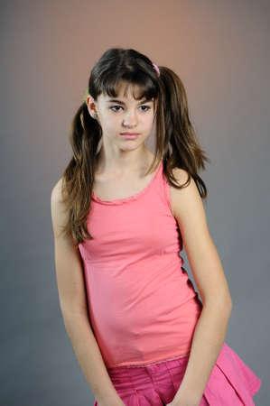 girl posing in pink clothing
