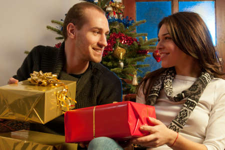 beautiful couple expressing happiness in christmastime