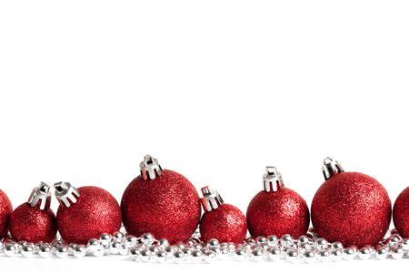 red christmas balls on white. studio shot