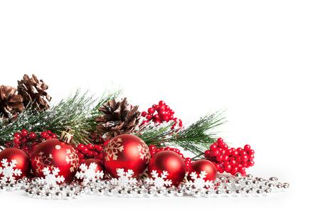 red christmas tree and balls on white. studio shot