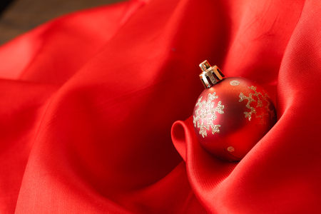 Small red decoration balls over red silk background