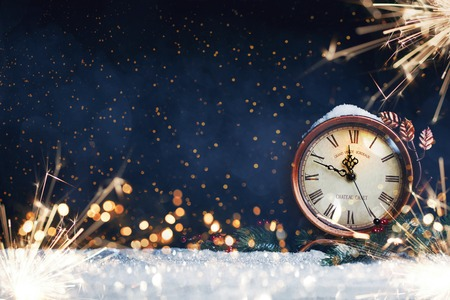 Photo for New Years clock. Decorated with balls, star and tree on snow - Royalty Free Image